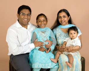 Indian family of four wearing beautiful sari for traditional family photograph
