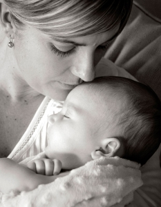 up close portrait of new mother and newborn baby in b&w