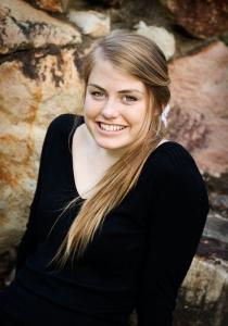 happy portrait of pretty teen girl wearing black long sleeved shirt