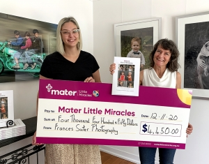 Coorparoo photographer Frances Suter holds cheque for Mater Little Miracles with Brittany from Mater Foundation in Brisbane studio