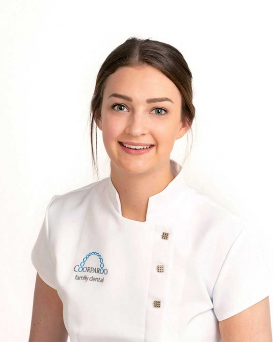 Dental assistant in uniform for corporate headshot
