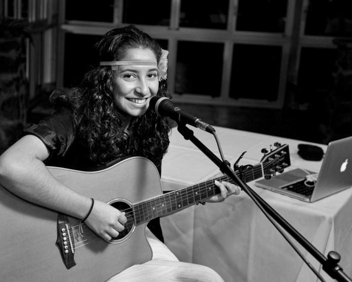 Young Brisbane musician holds guitar for creative corporate headshot